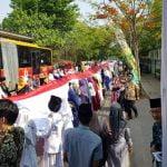 Peringati Hari Santri Nasional, Ponpes Asshiddiqiyah BentangkanBendera 700 Meter